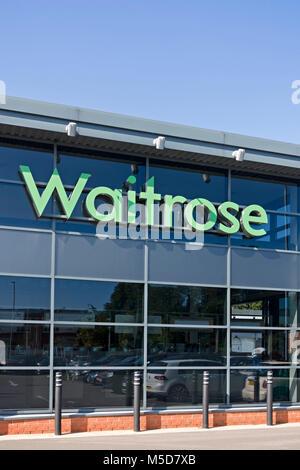 Waitrose logo on front of supermarket in Market Harborough, Leicestershire, England, UK - Stock Photo