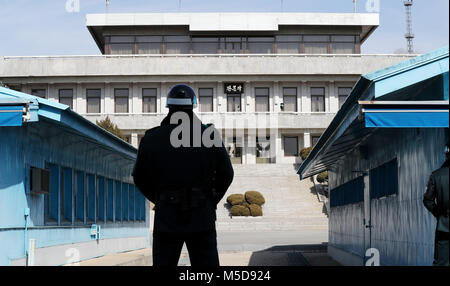 21st Feb, 2018. Truce village A South Korean soldier stands guard at the truce village of Panmunjom on Feb. 21, 2018. South Korea and North Korea have recently seen a thaw in their ties on the occasion of the ongoing Winter Olympics in the South. Credit: Yonhap/Newcom/Alamy Live News