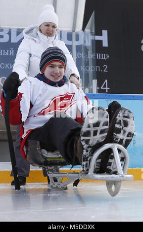 MOSCOW, RUSSIA - FEBRUARY 22, 2018: Denis takes part in a para ice hockey training at an outdoor arena of Park of - Stock Photo