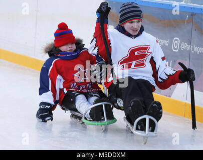 MOSCOW, RUSSIA - FEBRUARY 22, 2018: Mikhail (L) and Denis take part in a para ice hockey training at an outdoor - Stock Photo