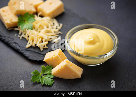 Homemade cheese sauce in glass bowl - Stock Photo
