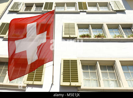 Row Of Houses Of The Old Town Of Zurich Reflected On The