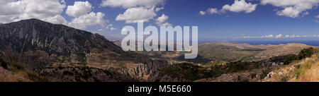 Panoramic view of clouds over the rugged landscape of central Crete - Stock Photo