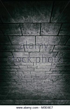 Stone bridge underneath underside bricks arch - Stock Photo