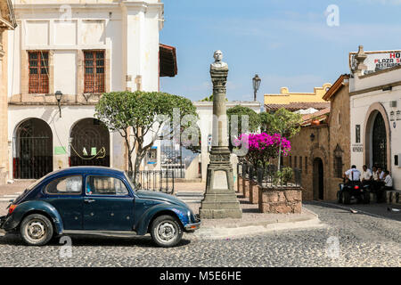 TAXCO, MEXICO - march 3, 2012: View of one of the central streets with typical VW Beetle car in Taxco, Mexico - Stock Photo