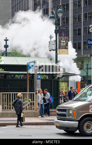 New York, NY, USA - June 06, 2015:Steam coming out of Greeley Square and the intersection West 32 in Manhattan in - Stock Photo