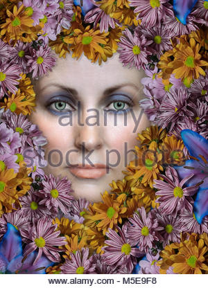 Woman's face surrounded by flowers - Stock Photo
