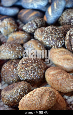 A selection of rolls and baps bagels ready for sale on an artisan bakery stall at london borough market. Artisan - Stock Photo