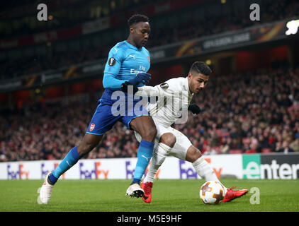 Arsenal's Danny Welbeck (left) and Ostersunds FK's Hosam Aiesh battle for the ball during the UEFA Europa League - Stock Photo