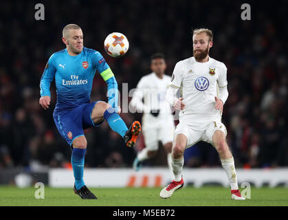 Arsenal's Jack Wilshere (left) and Ostersunds FK's Curtis Edwards battle for the ball during the UEFA Europa League - Stock Photo