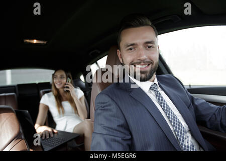 Attractive elegant serious man drives good car - Stock Photo