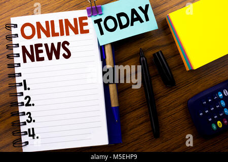 Word, writing Online News. Business concept for Online Newspaper Article written on book note paper on wooden background. - Stock Photo