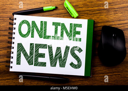 Handwriting Announcement text showing Online News. Business concept for Online Newspaper Article written on notebook - Stock Photo