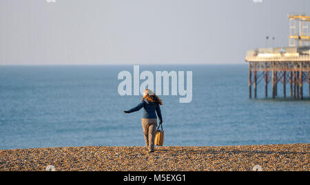 Brighton UK 23rd February 2018 - A beautiful sunny but cold morning on Brighton beach as freezing temperatures and - Stock Photo