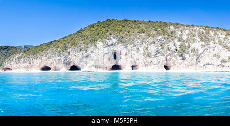 panorama of Cala Luna caves in the gulf of Orosei Sardinia Italy - Stock Photo
