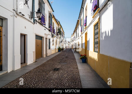 Cordoba, Spain - April 12, 2017: Old typical street in the Alcazar Viejo quarter of Cordoba with white walls decorated - Stock Photo