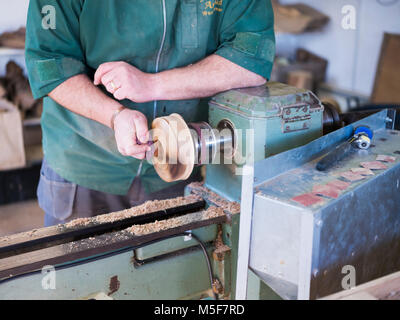 A woodworker, demonstrating spinning. - Stock Photo