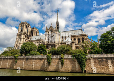 View of famous Notre-Dame de Paris Cathedral under beautiful sky in Paris, France. - Stock Photo