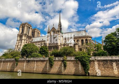 View of famous Notre-Dame de Paris Cathedral under beautiful sky in Paris, France.