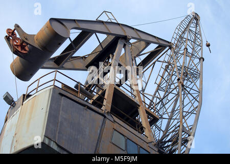 View of an old industrial crane in the ancient port of Genoa, Genova, Italy - Stock Photo