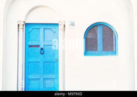 white facade with blue door, window, arch and beautiful columns of traditional Mediterranean house in Ravello, Italy - Stock Photo
