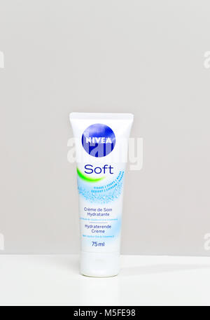 Nivea hand and body lotion tube on white background - Stock Photo