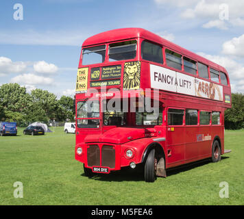 Enfield, London, UK - May 25 2014: Red London routemaster bus standing in a field on display. - Stock Photo