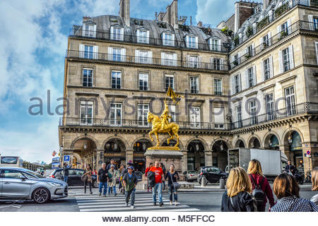 Jeanne d'Arc, a gilded bronze equestrian sculpture of Joan of Arc by Emmanuel Frémiet in the Place des Pyramides - Stock Photo