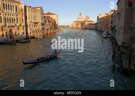 A Gondola on the Grand Canal, Venice viewed from The Ponte dell Accademia  (Academy Bridge) with the Santa Maria - Stock Photo