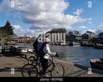 Two Cyclists looking at Eel Pie Island in Twickenham greater London Uk - Stock Photo