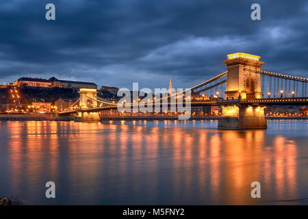 Highlighted Chain bridge in Budapest at night - Stock Photo