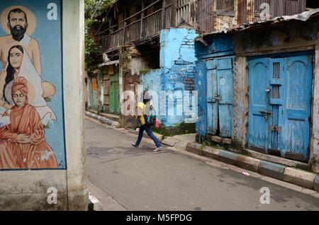 Girl backpack blue jeans walking on road, jodhpur, rajasthan, India, Asia - Stock Photo