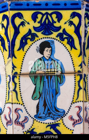 Set of typical Catalan mosaics, with animal and nature motifs, and oriental figure. Barcelona, Spain. - Stock Photo