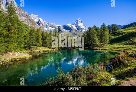 View of the Blue lake (Lago Blu) near Breuil-Cervinia and Cervino Mount (Matterhorn) in Val D'Aosta,Italy - Stock Photo