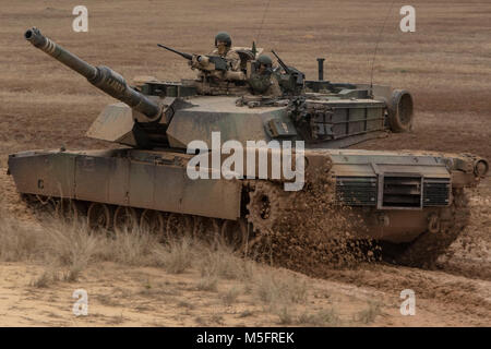 An M1A1 Abrams tank with 2nd Tank Battalion, 2nd Marine Division maneuvers toward its firing position during semi - Stock Photo