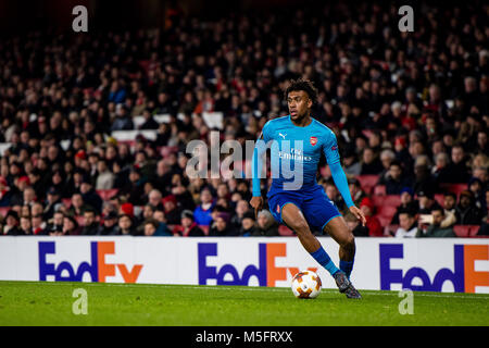 LONDON, ENGLAND - FEBRUARY 22: Alex Iwobi (17) of Arsenal during UEFA Europa League Round of 32 match between Arsenal - Stock Photo