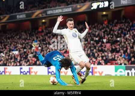 LONDON, ENGLAND - FEBRUARY 22: Mohamed Elneny (35) of Arsenal, Jamie Hopcutt (8) of Ostersunds FK, runs with the - Stock Photo