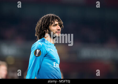 LONDON, ENGLAND - FEBRUARY 22: Mohamed Elneny (35) of Arsenal during UEFA Europa League Round of 32 match between - Stock Photo