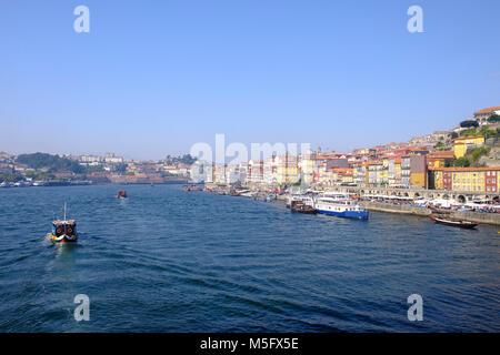 Douro River waterfront in Barrio La Ribeira with boat traffic, Porto, Porto Region, Portugal - Stock Photo