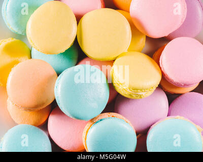 Colorful macaroons. Sweet macarons on retro dark background with copy space. Top view, Holiday time concept - Stock Photo