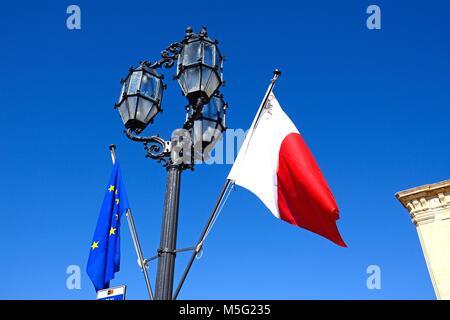 Maltese and EU flag on a lamppost, Valletta, Malta, Europe. - Stock Photo