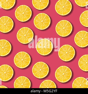 Lemon slices pattern on vibrant pomegranate color background. Minimal flat lay food texture - Stock Photo