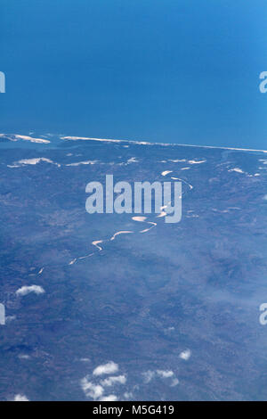 Aerial view of a dry river running inland taken from a plane, Coastline, Africa - Stock Photo