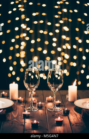 wineglasses on table with candles - Stock Photo