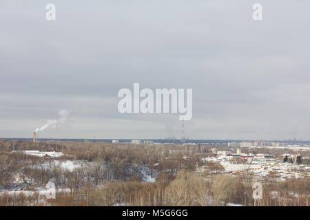 Industrial district in Russia, cloudy winter day - Stock Photo