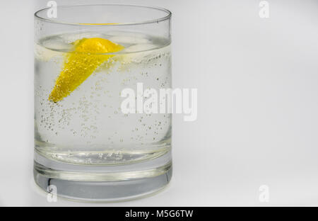 Close-up of a gin and tonic in a glass tumbler - Stock Photo