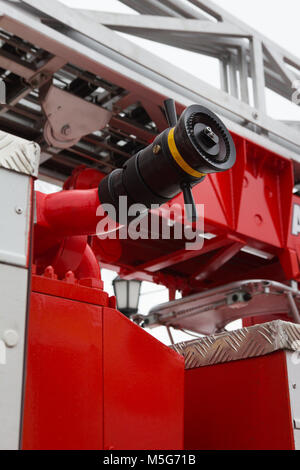 Water hoses in Fire truck - big red Russian fire fighting vehicle - Stock Photo