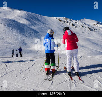 Pila, Aosta, Italy - Feb 19, 2018: Female skier with a jacket written ITA which is short for Italy and pants with - Stock Photo