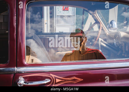 The reflection of a man in the window of a vintage Chevy car. - Stock Photo