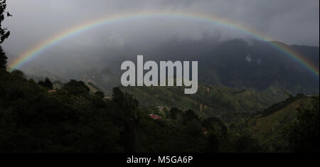 Rainbow over hills farmland Costa Rica - Stock Photo